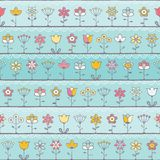 Baby blue background with cute flowers Stock Image