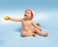 Baby on blue background Stock Photos