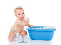 Baby beside blue basin Royalty Free Stock Photos