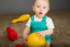 Baby in a blue bib pants Stock Photography