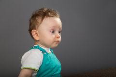 Baby in a blue bib pants Stock Photo