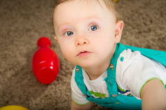 Baby in a blue bib pants Royalty Free Stock Photography
