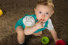 Baby in a blue bib pants Royalty Free Stock Photos