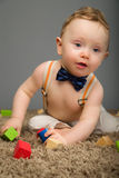 Baby in a blue bow tie Stock Photo