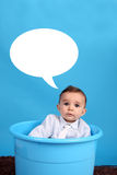 Baby on a blue bucket Stock Photography