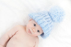 Baby with blue cap Royalty Free Stock Photography