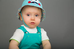 Baby in a blue cap Stock Photography