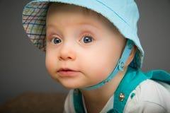 Baby in a blue cap Stock Photos