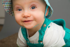 Baby in a blue cap Royalty Free Stock Photos