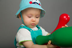 Baby in a blue cap Royalty Free Stock Images