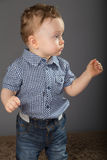 Baby in a blue checkered shirt Stock Photos