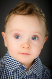 Baby in a blue checkered shirt Royalty Free Stock Photo