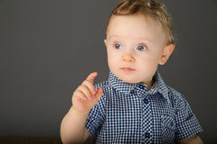 Baby in a blue checkered shirt Royalty Free Stock Images