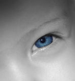 Baby Blue Eyes. Black and white close up of babies blue eye royalty free stock photography