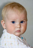 Baby with blue eyes Stock Image