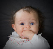 Baby Blue Eyes. Six month old baby girl with big blue eyes Stock Photo