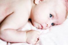 Baby with blue eyes Stock Photo