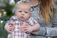 Baby with blue eyes and a dazed expression Royalty Free Stock Image