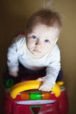 Baby blue eyes, driving a toy car Royalty Free Stock Image