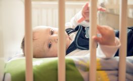Baby with blue eyes playing at home Stock Photography