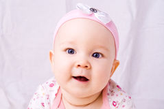 Baby with blue eyes smiling Stock Photography