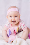 Baby with blue eyes smiling Stock Photo