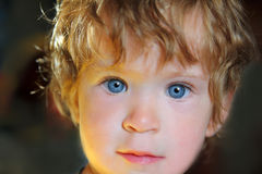 Baby with blue eyes in sunlight Royalty Free Stock Photos