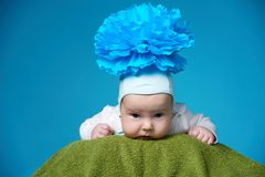 Baby with blue flower on head Stock Images