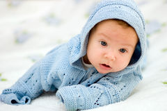 Baby in blue jacket. Portret of a baby in blue jacket stock image