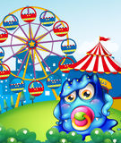 A baby blue monster at the carnival. Illustration of a baby blue monster at the carnival Stock Images