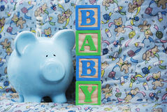 Baby with Blue Piggy Bank royalty free stock photos
