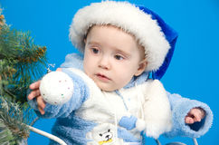Baby in blue Santa Claus hat Stock Photo