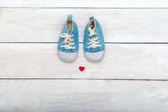 Baby blue shoes on wooden background. flat lay Stock Photo