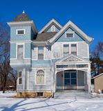 Baby Blue in Snow. This is a Winter picture of a house in Ottawa, Illinois.  The house is an example of the Italianate architectural style and features side
