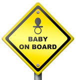 Baby on board drive careful warning sign. Baby on board, sign warning for presence of baby in car or vehicle, drive safe and careful, yellow diamond icon safety Royalty Free Stock Photo