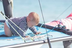 Baby on board of sea yacht Royalty Free Stock Images