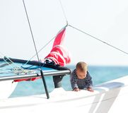 Baby on board of sea yacht Royalty Free Stock Image