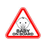Baby on board sign with child boy smiling face with nipple silhouette in red triangle on a white background. Stock Photos