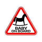 Baby on board sign with child horse silhouette in red triangle on a white background. Car sticker with warning. Royalty Free Stock Photo