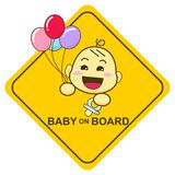 Baby on board sign, Baby smiling and holding balloon Stock Photo