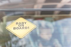 Baby On Board sticker on the car back windows Stock Photo