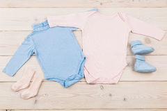 Baby bodysuits and socks stock image