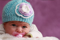 Baby with bonnet. One month baby girl with blue bonnet Stock Photos