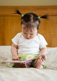 Baby with book stock images