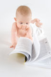Baby with book. On white Royalty Free Stock Image