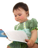 Baby with book Stock Photos