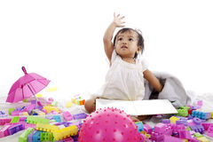 Baby with book and blocks Stock Photography