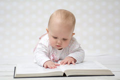 Baby with the book Royalty Free Stock Photos