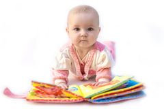 Baby with book. Baby playing with story book Royalty Free Stock Photo