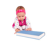 Baby and book Stock Images